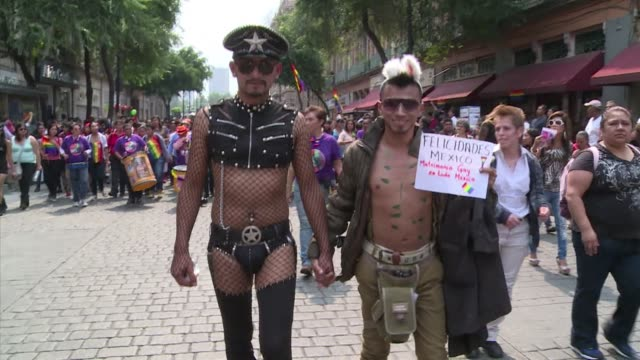 Tens of thousands of Mexicans march in the streets of the capital celebrating a key ruling by the Supreme Court that opens the door to samesex...