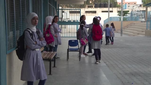 tens of thousands of palestinian children return to united nations run schools after the summer break though the future of the schools remain in... - palestinian stock videos & royalty-free footage