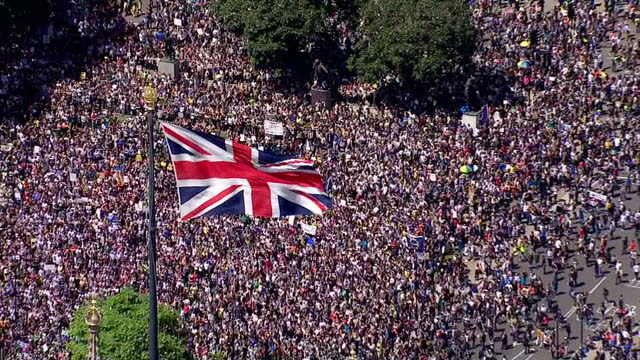 stockvideo's en b-roll-footage met tens of thousands of people are expected to take part in a march from park lane to parliament, in london, to protest against the recent eu referendum... - brexit