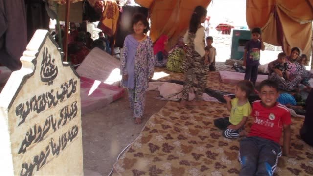 tens of thousands of people fleeing militants have sought refuge in the small northern iraqi town of sinjar cramming into schools and mosques - sinjar stock videos & royalty-free footage