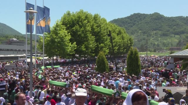 tens of thousands of people gather in srebrenica to commemorate the 20th anniversary of the massacre of thousands of muslims in the worst mass... - srebrenica stock videos and b-roll footage