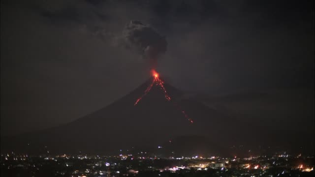 vídeos de stock, filmes e b-roll de tens of thousands of people have been evacuated from around the erupting mayon volcano as a white hot cocktail of gas and volcanic debris streaks... - human fertility