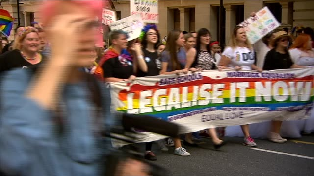 tens of thousands of people have taken to the streets in support of same sex marriage sydney hs huge crowds march along street vs / drag queen in... - political rally stock videos & royalty-free footage