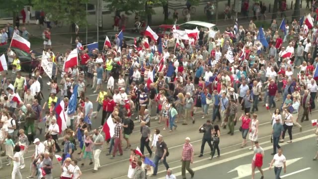 tens of thousands of people march across downtown warsaw protesting against government policies they believe threaten democracy, as the country marks... - warsaw stock videos & royalty-free footage