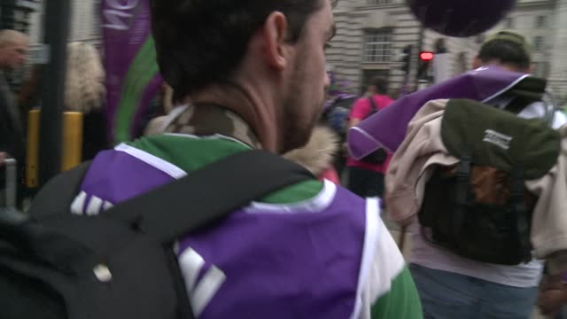 tens of thousands of people marched through central london on saturday to protest against falling real wages and public spending cuts introduced to... - tame stock videos and b-roll footage