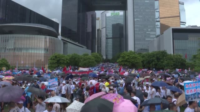 tens of thousands of people rally in support of hong kong's police and pro beijing leadership a vivid illustration of the polarisation coursing... - leadership illustration stock videos & royalty-free footage
