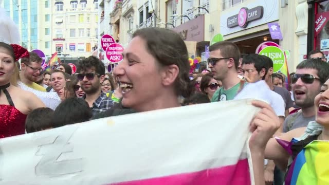 stockvideo's en b-roll-footage met tens of thousands of people took part on sunday in istanbuls gay pride parade with a very political tone a year after the revolt against the islamic... - kleurtoon