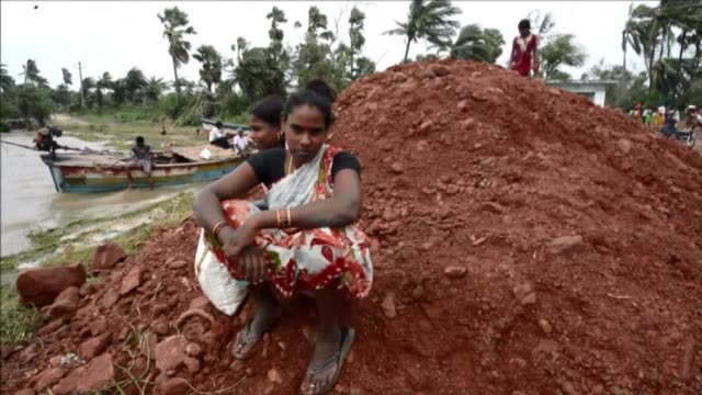stockvideo's en b-roll-footage met tens of thousands of people who fled india strongest cyclone in 14 years return to discover their homes and livelihoods destroyed as a massive relief... - bhopal