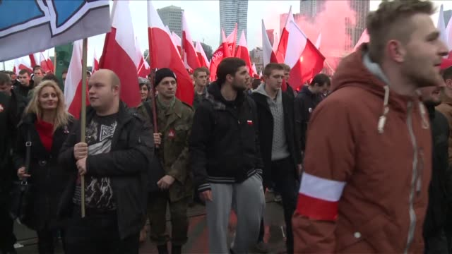 tens of thousands of protesters gather on the streets of warsaw for a demonstration organised by the far right marching under the slogan poland for... - poland stock videos & royalty-free footage