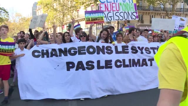tens of thousands of protesters take to the streets of paris to demand that governments take action against climate change as key un talks attempt to... - paris agreement stock videos & royalty-free footage