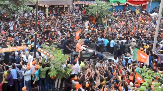 tens of thousands of supporters gather in the holy city of varanasi as the indian prime minister narendra modi steps up election campaigning - political rally stock videos & royalty-free footage
