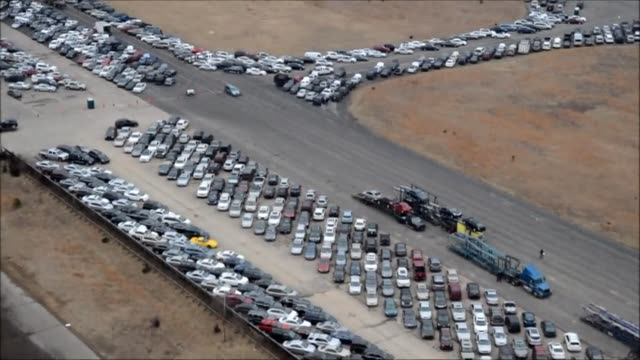 tens of thousands of vehicles damaged by super storm sandy are being temporarily stored on runways and taxiways at calverton executive airpark in... - taxiway stock videos & royalty-free footage