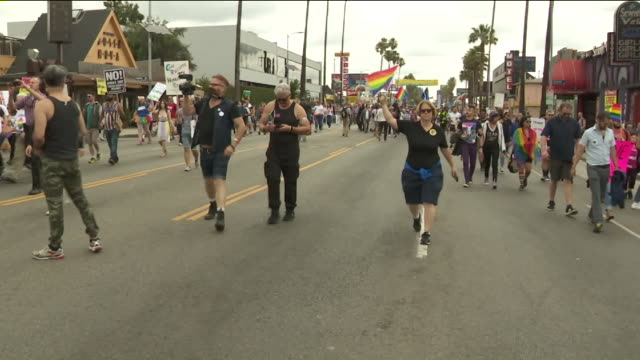tens of thousands participate in west hollywood resist march during l.a. pride. - west hollywood stock-videos und b-roll-filmmaterial