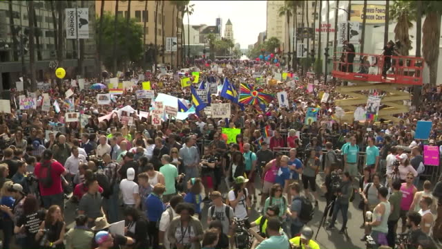 ktla tens of thousands participate in west hollywood resist march during la pride - marching stock videos and b-roll footage