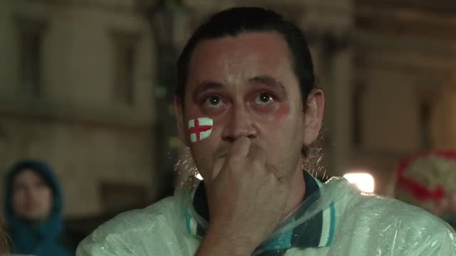 tense england fans in trafalgar square during extra time as the score stays equalised at 1-1. england supporters at the fan zone in trafalgar square... - international landmark stock videos & royalty-free footage