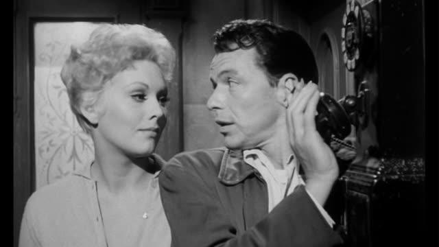 1955 tension arises when man (frank sinatra) sees woman (kim novak) in the hallway - 1950 stock videos & royalty-free footage