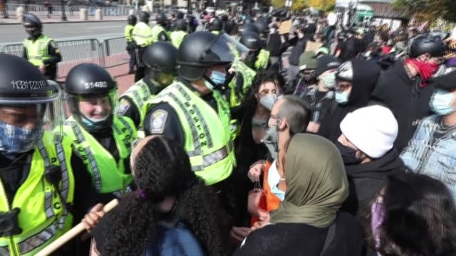 tensions are high in copley square, boston, where a heavy police presence clashes with counter-protesters facing off behing barricades with a... - back bay boston stock videos & royalty-free footage