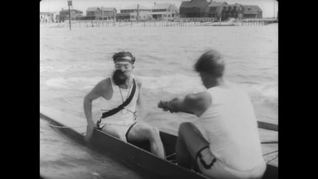 1927 tensions rise when man's (buster keaton) rowing team fends off the rivals - sculling stock videos & royalty-free footage