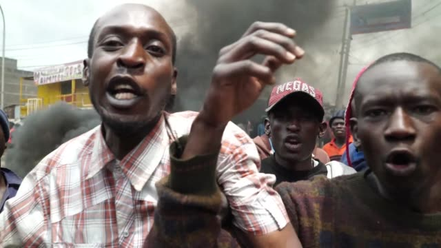 tensions soar in kenyan opposition leader raila odinga's strongholds in nairobi in mathare slum protesters place burning barricades along a main road... - raila odinga stock videos and b-roll footage