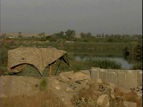 stockvideo's en b-roll-footage met tent at patrol base murray near bank of tigris river / arab jabour iraq / audio - rivieroever