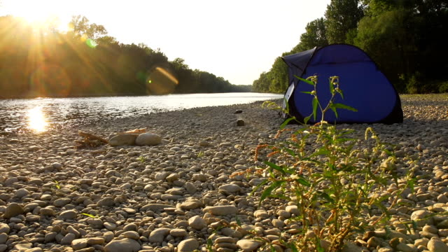 hd dolly: a tent by the river - tent stock videos and b-roll footage