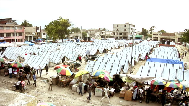 tent city of earthquake survivors - haiti stock videos & royalty-free footage
