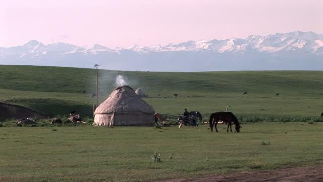 tent set up in grassland, xinjiang, china - xinjiang province stock videos & royalty-free footage