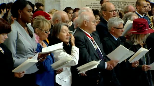 london memorial service st paul's cathedral ints england london st paul's cathedral int gvs service congragation singing hymn natsot / choir singing... - memorial event stock videos and b-roll footage
