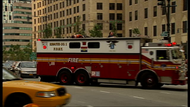tenth anniversary: the british garden at hanover square; usa: new york: new york city: ext ambulance along with flashing lights and siren sot traffic... - september 11 2001 attacks stock videos & royalty-free footage