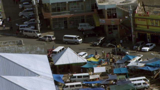tents cover street market booths in kingston, jamaica. - jamaica stock videos & royalty-free footage