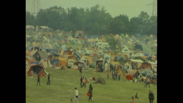 tents on campsite at worthy farm for people attending the 1983 glastonbury festival - attending stock videos & royalty-free footage