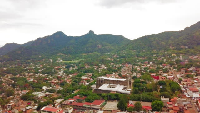 tepoztlán city from the air - tepoztlan mountains stock videos and b-roll footage