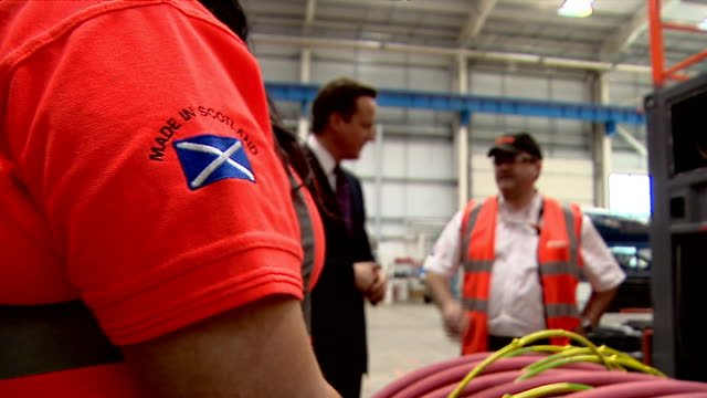 teresa may proposes minimum price per unit of alcohol for england and wales; scotland: dumbarton: int various of david cameron mp chatting to factory... - lager stock videos & royalty-free footage