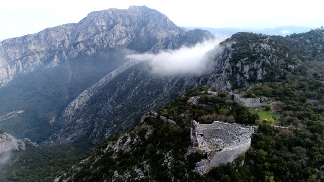 termessos ancient city and theatre drone shots - mounts taurus and clouds - ancient rome stock videos & royalty-free footage