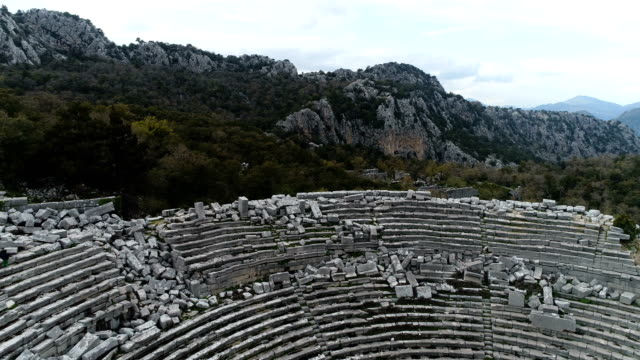 termessos ancient city and theatre drone shots - mounts taurus and clouds - ancient greece stock videos & royalty-free footage