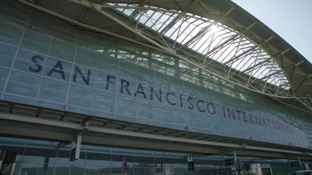 ms pov of sfo terminal exterior - san francisco international airport stock videos & royalty-free footage