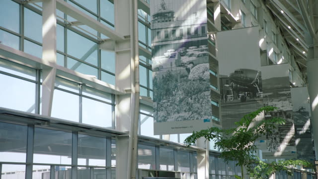 ms pov sfo terminal, vintage aviation posters on wall - san francisco international airport stock videos & royalty-free footage