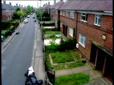 Terrace of houses along street in low-income housing estate.
