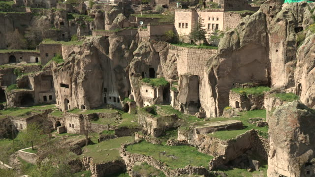 terraced housing, guzelyurt, turkey - cliff dwelling stock videos & royalty-free footage
