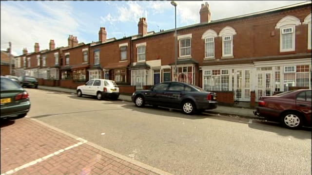 terraced street and house folded pushchair outside house house exterior - folded stock videos and b-roll footage