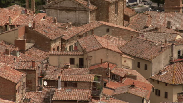 terracotta rooftops characterize montepulciano, italy. available in hd. - montepulciano stock videos & royalty-free footage