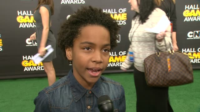 terrell ransom, jr. on being at the event at cartoon network hosts fourth annual hall of game awards at barker hangar on february 15, 2014 in santa... - barker hangar stock videos & royalty-free footage