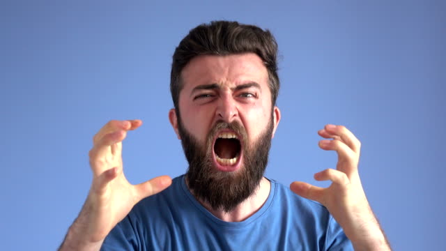 terrified afdult man screaming and expressing anger emotion - barba peluria del viso video stock e b–roll