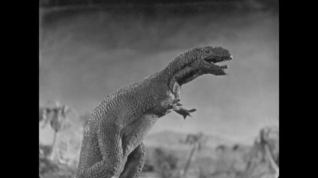 1925 Terrified explorers with rifles watch as stop motion dinosaurs fight at night