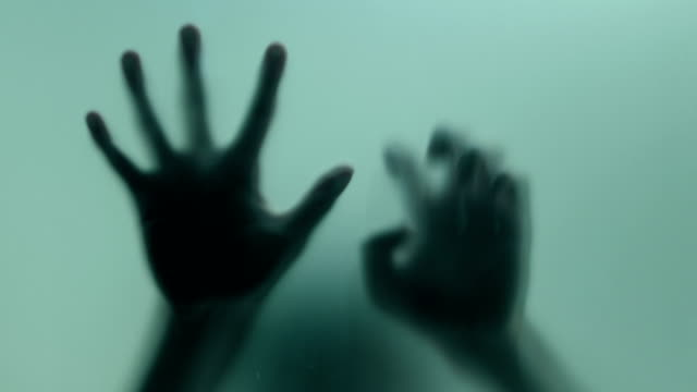 terrified hand on frosted glass - criminal stock videos & royalty-free footage