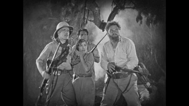 1925 terrified jungle explorers with rifles look on in horror - 1925 stock videos & royalty-free footage