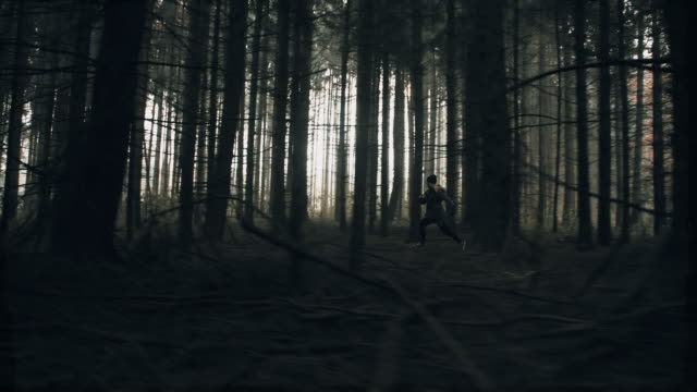 Terrified woman running in the forest