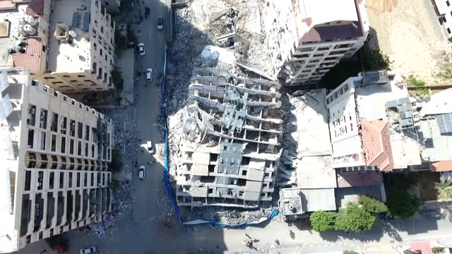 terrifying aerial footage from gaza shows damaged buildings and places in the aftermath of 11 days of israeli airstrikes on the blockaded gaza strip.... - striscia di gaza video stock e b–roll