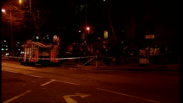 scene of explosion england london white city police officers at scene directing traffic / police road block / police officer talking to driver in car... - seilabsperrung stock-videos und b-roll-filmmaterial