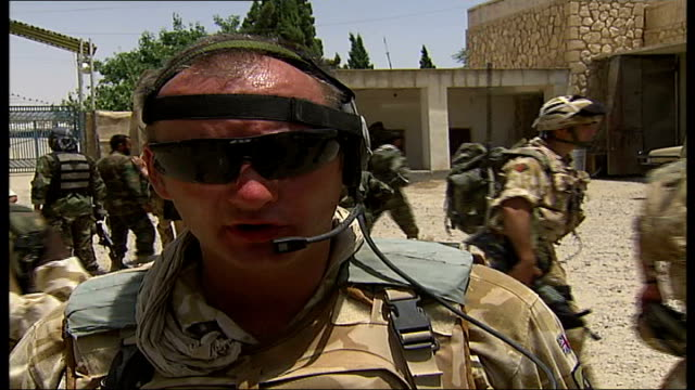 territorial army bolstering troop numbers in helmand province troops now wearing helmets entering afghan army compound after withdrawing from patrol... - esercito nazionale afgano video stock e b–roll